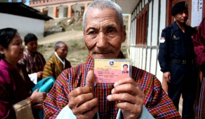 Bhutanese man showing his voter card as he waits  to cast his vote (Source: Daily Maverick)